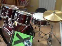 Burgundy acoustic 5 piece drum kit.