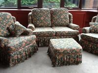3 Piece Suite with Footstool . - 2 seater sofa & 2 Chairs . Removesble covers. Green floral fabric