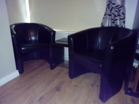 2 Black Leather Tub Chairs & Matching glass black table £150ono