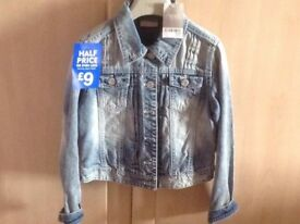 Brand new with tags. Next girls denim jacket. Age 10