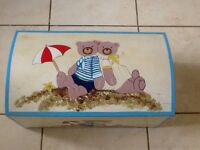 Wooden painted toy box, 55cms long, 18cms deep with an arched top .great for a small room