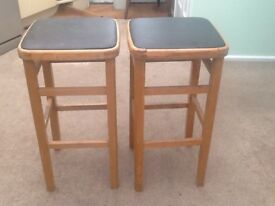 A pair of wooden stools