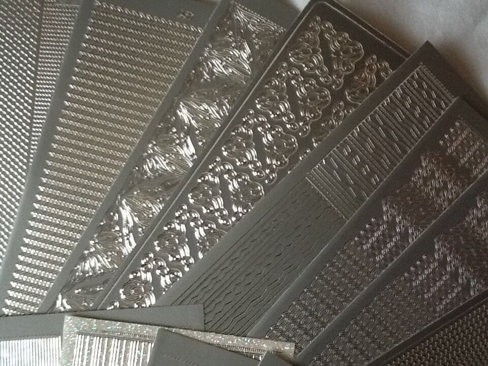 27 SHEETS OF PEEL OFF STICKERSSET Cin Ipswich, SuffolkGumtree - 27 SHEETS OF PEEL OFF STICKERS SET C ASSORTMENT OF SILVER BORDERS AND EDGES BRAND NEW UNUSED 27 SHEETS EXCELLENT VALUE 10p A SHEET £2.70