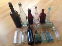 collection of vintage glass bottles ,some unique.