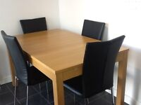 Dining table and 4 chairs good condition selling due to new kitchen