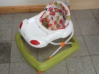 Baby walker in excellent condition-washed and cleaned-folds compact for transport and storage