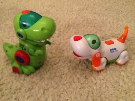 Dino Tech 1.0 and Dog Tech 1.0, battery operated dinosaur and puppy, spin around to music