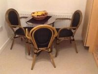 CASUAL TABLE WITH THREE CHAIRS IN REALLY GOOD CONDITION