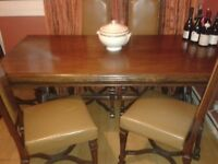 Real wood dining table and 6 chairs worth £2000