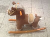 £5 -rocking horse with handles at font to hold onto-used but in good condition-cost of new is £60