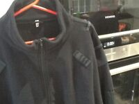 Black security type mans zipper jacket used five times.