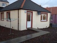 Compact two bedroom cottage with large sunny chipped garden. Recently refurbished.