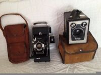 Two vintage cameras and there cases,good condition.