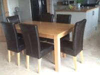 Light oak dining table with 6 brown leather chairs