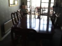 Red mahogany extending dining table and six chairs