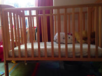 Mama & Papa's wooden dropside cot from birth to toddler bed (w/out matrass)