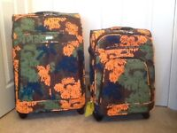2 matching suitcases