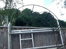 Wrought iron garden rose arch