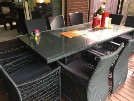 table with ten chairs for the outside