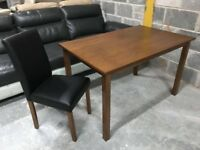 Wood dining table with black or cream leather chairs