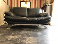 Black leather sofa. Great condition. Chrome curved legs.