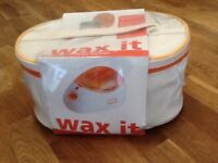 Portable wax heater