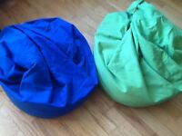 Two beanbags in excellent condition,can be easily washed. One is blue and the other lime green.