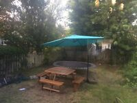 Garden table with 8 seats and big blue umbrella