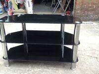 Black glass/ chrome legged tv stand