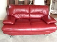 Red leather 3 and 2 seater sofas. Two year old and very good condition. Buyer uplifts. £200