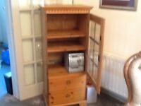 Pine cabinet with three shelves and two drawers