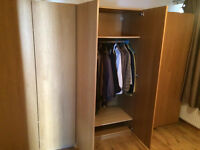 Three oak veneer wardrobe units in immaculate condition with shelving baskets