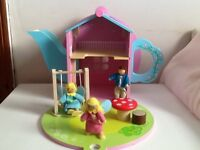 Lovely wooden tea pot house and fairies ,swing and table etc