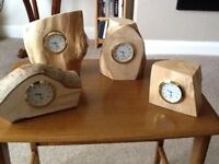 Hand made wooden surrounds with metal brass coloured watch type battery clock inserts.