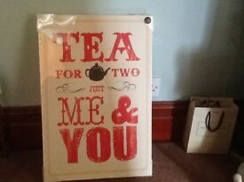 A LARGE CANVAS PRINT PICTURE FROM NEXT, CREAM WITH RED WORDING ( STILL HAS PACKAGING ON )