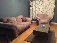 Sofa bed and armchair in excellent condition for sale.