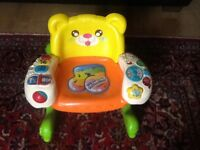 Child learning roking chair with lots of activities & musical activities in good condition