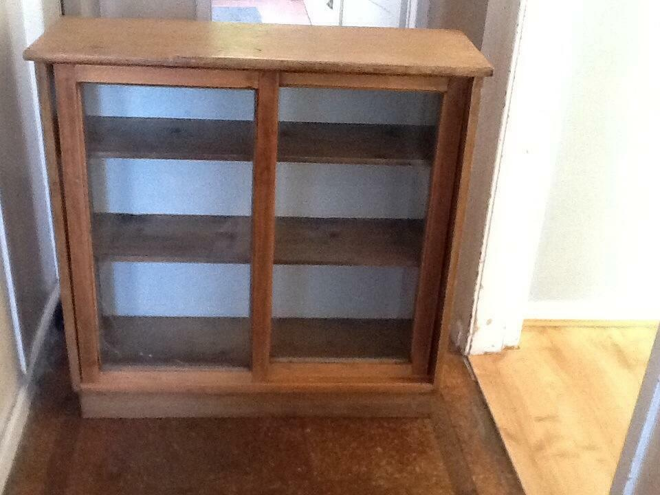 Wooden cabinet with shelves and glass sliding doors in for Sliding glass doors gumtree
