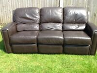 A used three seat reclining and two seat brown leather settee