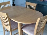 EXTENDABLE DINING TABLE AND FOUR MATCHING CHAIRS