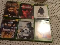 Laptop bag ,dvds,Xbox games,traines ,