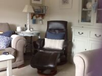 BROWN LEATHER RECLINING SWIVEL CHAIR AND MATCHING FOOTSTOOL