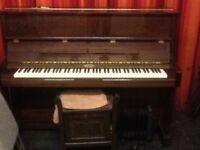 Kemble upright piano in polished mahogany