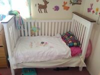 Large white wooden cot bed