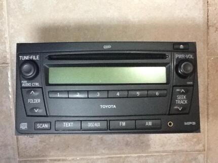 Toyota Genuine stereo Radio CD Aux INSTALLED. Works perfectly.