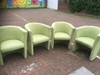 4 green bucket chairs