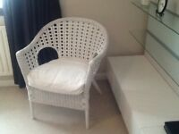 White wicker chair with white cushion.