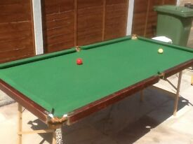 A table top pool or snooker table 2m x 1m