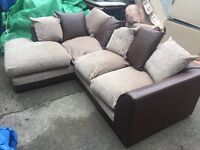 LUXORIOUS CORNER SOFA IN FABRIC AND BROWN LEATHERETTE.