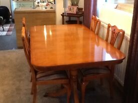 Yew wood dining table and six chairs